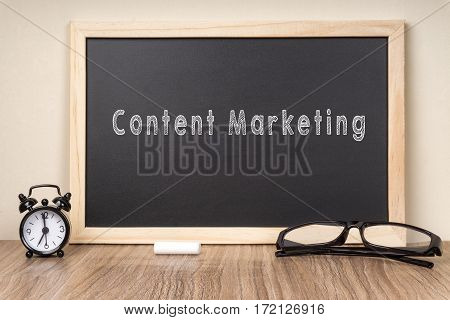 Content Marketing word on chalkboard with chalk