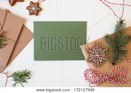 Christmas Card With Your Copy Spase. Xmas Cookies, Ribbon, Kraft Envelope, Fir Branches On White Woo