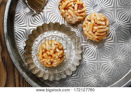 Chak-chak traditional asian sweet dessert - fried dough with honey