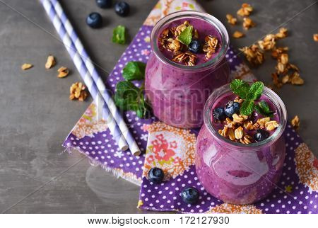 Berry yogurt with bran and oatmeal on a metal background