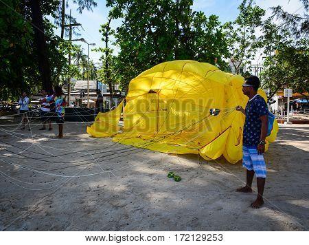 People Playing Parasailing In Phuket, Thailand