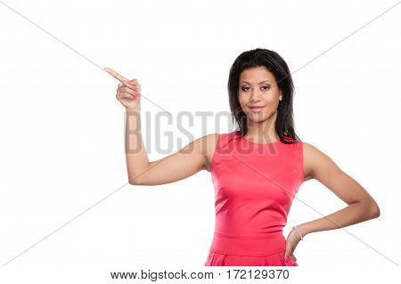 Pretty mixed race woman pointing at empty blank copy space. Girl isolated on white. Advertisement.