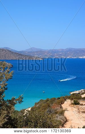 Elevated view of the sea and coastline with mountains to the rear Istro Crete Greece Europe.