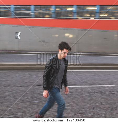 Beautiful Young Man Crossing The Street