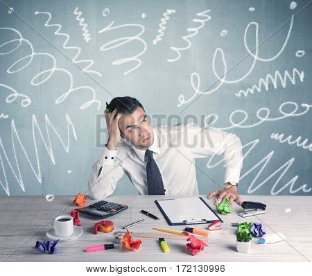 An elegant businessman sitting at office desk and working on keyboard with drawn curves, lines illustration on background wall concept