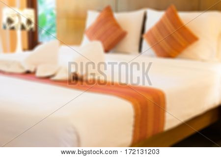 Abstract blurred empty modern bed in bedroom