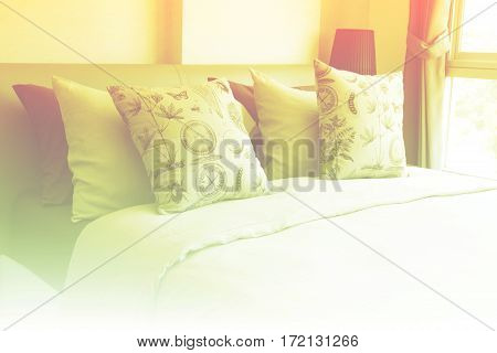 Empty modern bed in bedroom with color filters