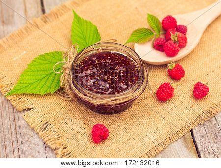 Fresh Raspberries And Jam On Wooden Table
