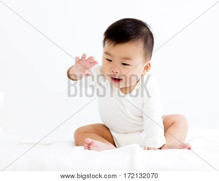 happy baby boy reaching his hands out