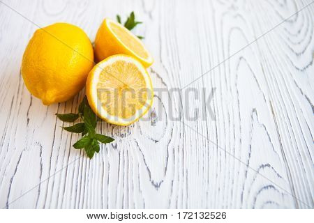 Juicy Lemons With Leaves Mint On A White Wooden Background. Lemon Slices. Fresh Lemon. Fresh Citrus
