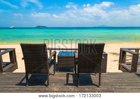 Beach chairs on the white sand beach at summer terrace restaurant - Phi-Phi island Krabi Province Thailand