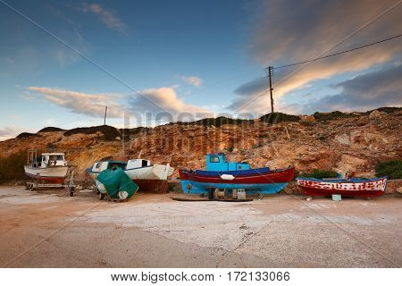 DONOUSSA, GREECE - FEBRUARY 03, 2017: Dry-docked fishing boats in the harbor of Donoussa island on February 03, 2017.