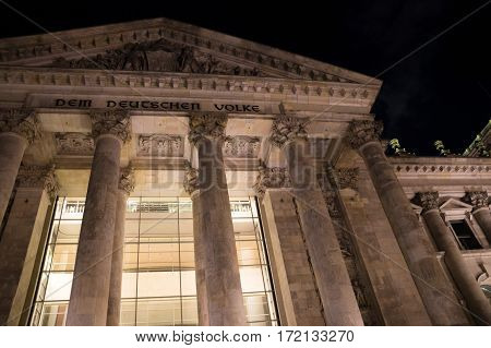 Nighttime close up view of famous Reichstag building in Berlin, Germany.