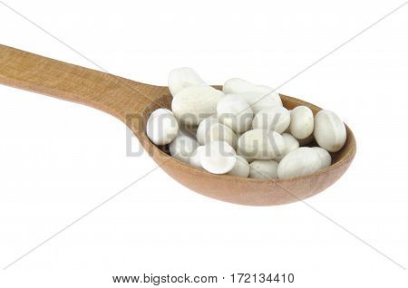 White beans in wooden spoon isolated on white background
