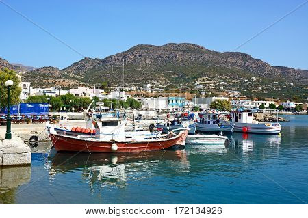 MAKRIGIALOS, CRETE - SEPTEMBER 18, 2016 - Traditional fishing boats in the harbour with views towards the mountains Makrigialos Crete Greece Europe, September 18, 2016.