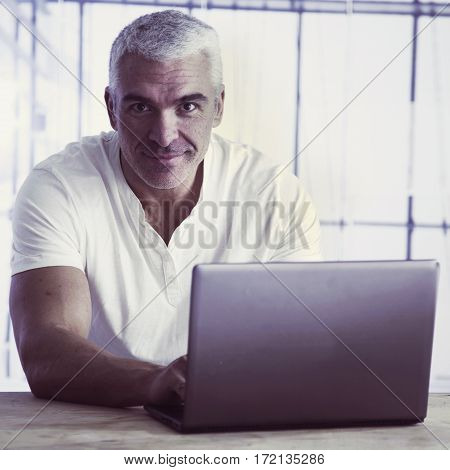 happy young business man working with laptop (Success knowledge victory money)