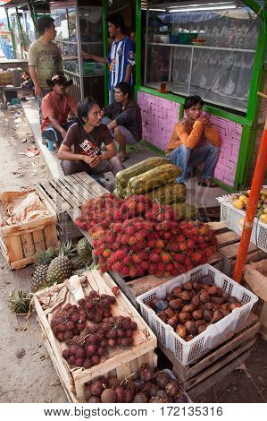 PARAPAT INDONESIA- AUGUST 182012:Men sell fruit in the market near pier