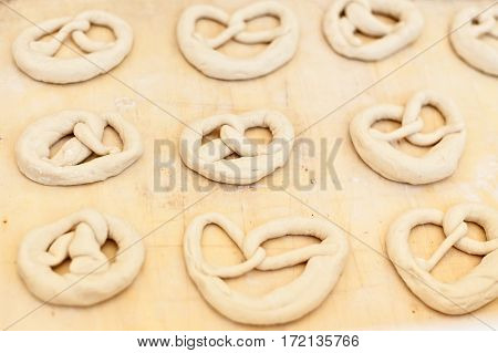 Uncooked pretzel ready to be baked over a board