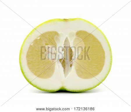 Sweetie citrus fruit cut in half, isolated on white background