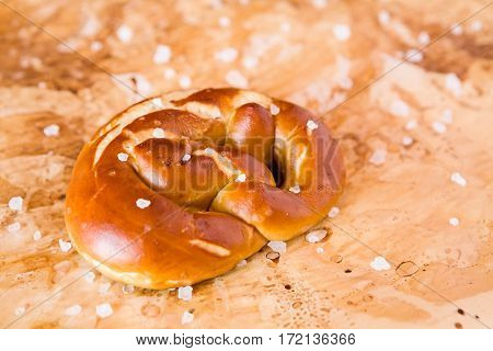Salty cooked pretzel over the greaseproof paper