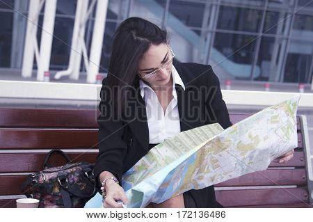 business woman using a map in the city (Tourism  travel acquaintance)