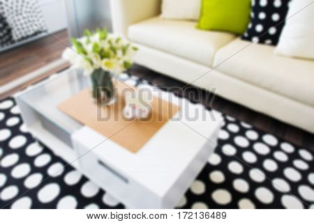 Abstract blurred modern interior decorated with flowers