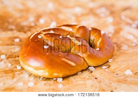 Closeup of salty cooked pretzel over the greaseproof paper
