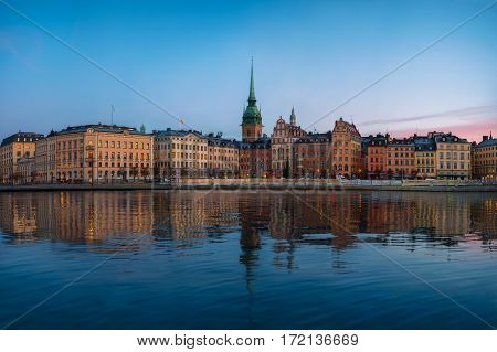 Stockholm old town at morning Colorful sunrise and reflections in water, Stockholm, Sweden, Gamla Stan