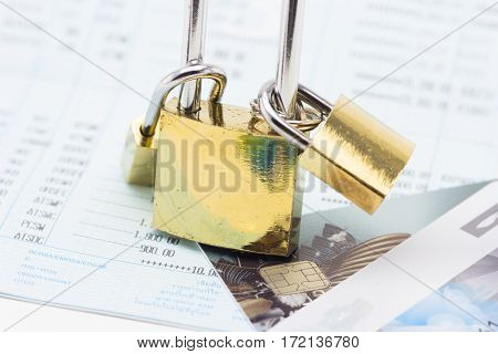 Credit card data security concept padlock with book bank