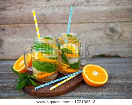 Fresh Cocktail With Orange, Mint And Ice, Selective Focus