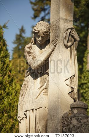 Woman on tomb as a symbol of depression and sorrow (antique statue)