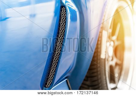 Close up on a blue car in sunlight