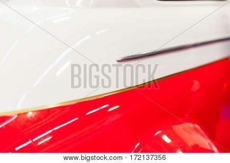 Closeup of a red and white vintage car