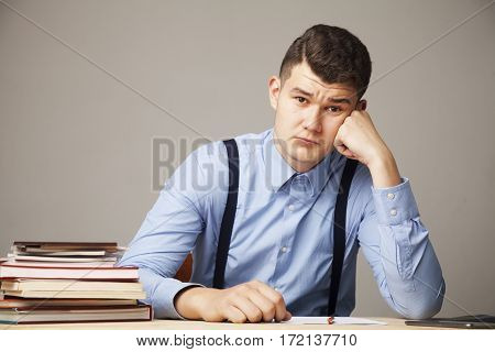 I hate my office work. Young businessman working with documents. (Low wages overtime working hours lack of career prospects unfreedom)