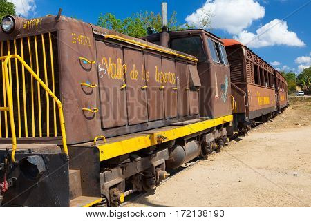 Manaca Iznaga Cuba - January 29 2017: Tourist train in the Valley of the Sugar Mills or Valle de los Ingenios a Unesco World Heritage site and a major tourist landmark in Cuba