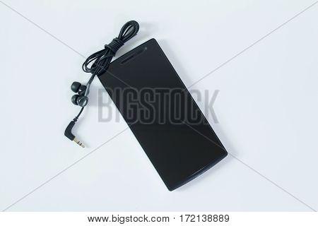 Smartphone and earphones on white background. Headphones Music