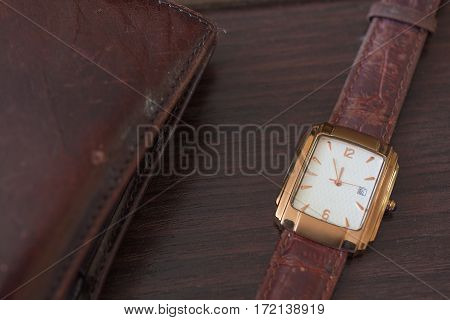 Golden Men's Wristwatch and Wallet. Classic Wristwatch for Man with Brown Strap.