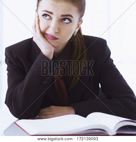 I hate my office work. Young businesswoman working with documents. Low wages overtime working hours lack of career prospects unfreedom concept. (Body language gestures psychology)