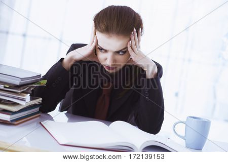 I hate my office work. Young businesswoman working with documents. (Low wages overtime working hours lack of career prospects unfreedom)