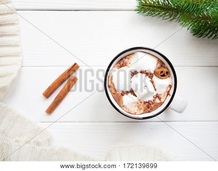 Hot Chocolate With Marshmallows In A Ceramic Cup, Plaid And Cinnamon On White Wooden Surface, Copy S