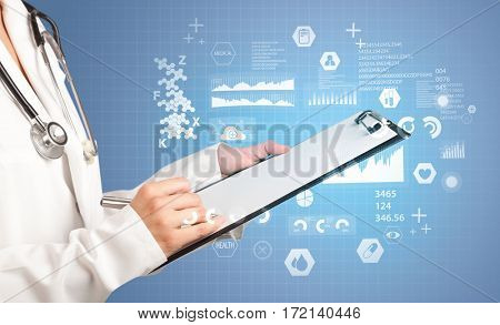 Female doctor holding notepad with blue background and data graphics