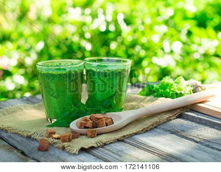 Green Smoothie With Spinach In A Glass On A Wooden Background