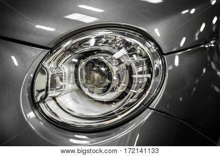 Closeup on headlight of a modern city car
