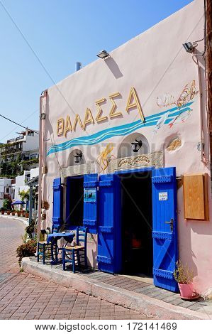 MAKRIGIALOS, CRETE - SEPTEMBER 18, 2016 - Traditional Greek taverna in the harbour area Makrigialos Crete Greece Europe, September 18, 2016.