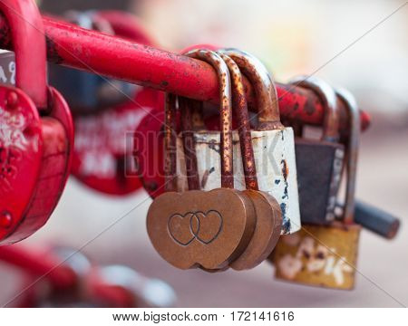 Red Padlocks Heart Shaped, Close-up On A Blurred Background.