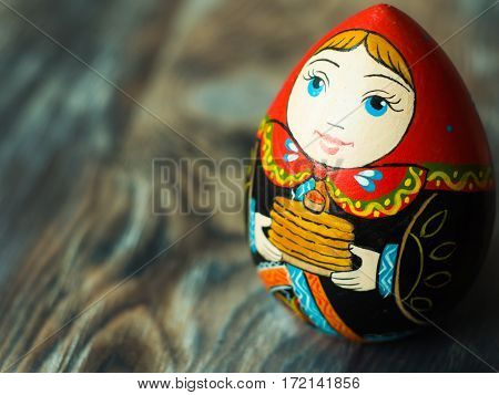 Close up of Russian traditional Doll. Wooden russian art. Homemade figure.