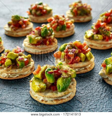 Salsa canape cracker appetizers with soft cheese.