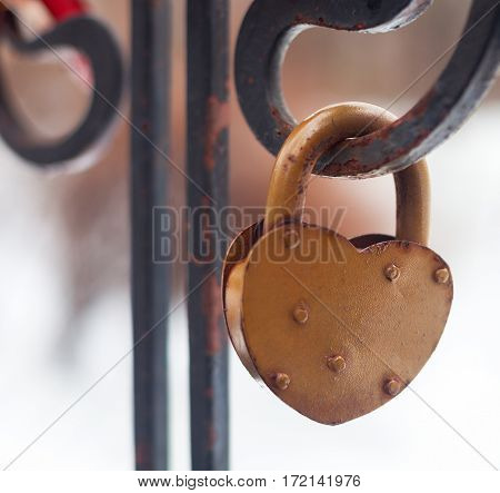 Vintage Closed Gold Padlock In Heart Shape Close Up On A Blurred Background.