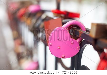 Vintage Closed Pink Padlock In Heart Shape Close Up On A Blurred Background.