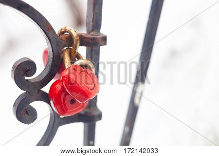 Vintage Closed Red Padlocks In Heart Shape Close Up On A Blurred Background.